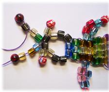 Zum Kindergeburtstag mit Perlen basteln